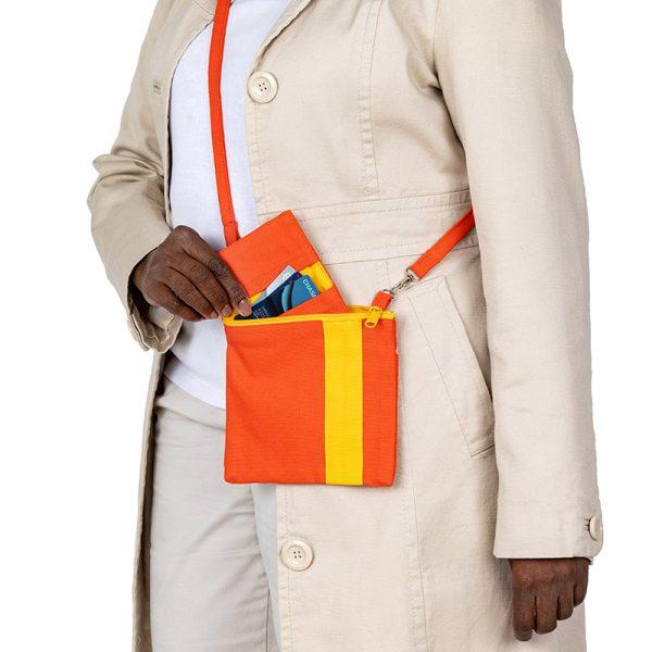 Mini Essentials Bag worn over the shoulder
