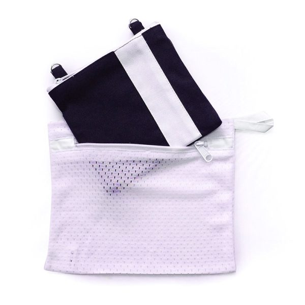 Image of a Mini Essentials Bag sliding into the wash bag for cleaning
