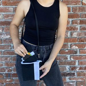 Essentials Bag shown being used by a model